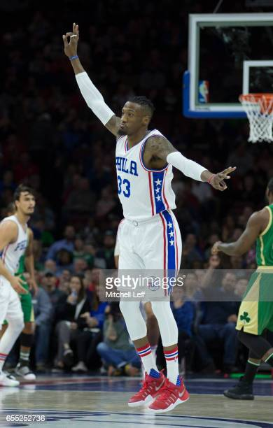Robert Covington of the Philadelphia 76ers reacts after making a basket against the Boston Celtics at the Wells Fargo Center on March 19 2017 in...