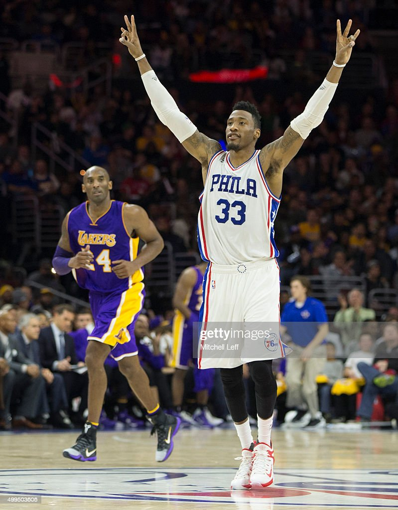 Robert Covington #33 of the Philadelphia 76ers reacts in front of Kobe Bryant #24 of the Los Angeles Lakers on December 1, 2015 at the Wells Fargo Center in Philadelphia, Pennsylvania.
