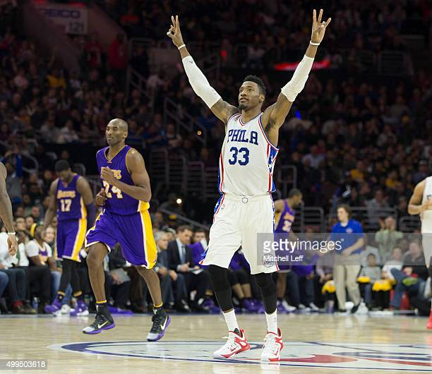 Robert Covington of the Philadelphia 76ers reacts in front of Kobe Bryant of the Los Angeles Lakers on December 1 2015 at the Wells Fargo Center in...