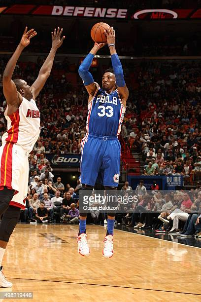 Robert Covington of the Philadelphia 76ers shoots against the Miami Heat on November 21 2015 at AmericanAirlines Arena in Miami Florida NOTE TO USER...