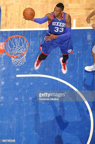 Robert Covington of the Philadelphia 76ers shoots against the Orlando Magic on December 21 2014 at Amway Center in Orlando Florida NOTE TO USER User...