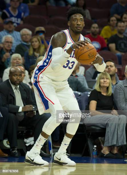 Robert Covington of the Philadelphia 76ers shoots the ball against the Memphis Grizzlies in the preseason game at the Wells Fargo Center on October 4...