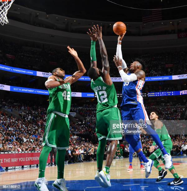Robert Covington of the Philadelphia 76ers shoots the ball against the Boston Celtics during the game on October 20 2017 at Wells Fargo Center in...