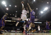 Robert Covington of the Rio Grande Valley Vipers shoots over Austin Freeman of the Iowa Energy on April 8 2014 during game one first round of the...