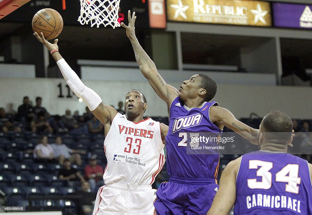 <a gi-track='captionPersonalityLinkClicked' href=/galleries/search?phrase=Robert+Covington&family=editorial&specificpeople=8607800 ng-click='$event.stopPropagation()'>Robert Covington</a> #33 of the Rio Grande Valley Vipers takes the ball to the basket against Larry Owens #23 of the Iowa Energy on April 8, 2014 during game one first round of the 2014 NBA-Development League playoffs at the State Farm Arena in Hidalgo, Texas.