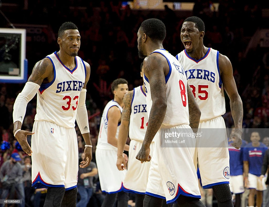 Robert Covington Tony Wroten and Henry Sims of the Philadelphia 76ers react after a made basket against the Cleveland Cavaliers on January 5 2015 at...