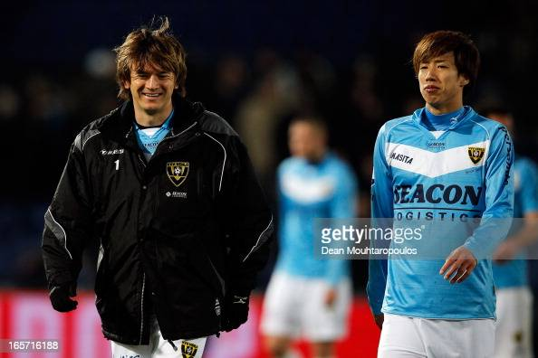 Robert Cullen and Yuki Otsu of Venlo walk off the ground after defeat in the Eredivisie match between Feyenoord and VVV Venlo at De Kuip on April 5...