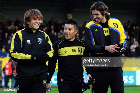 Robert Cullen of VVV Venlo and Mike Havenaar and Michihiro Yasuda of Vitesse share a laugh prior to the Eredivisie match between VVV Venlo and...