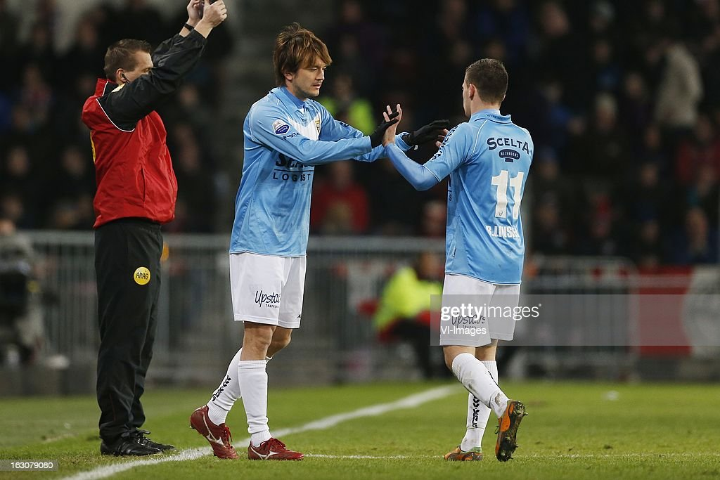 Robert Cullen of VVV-Venlo (C), Bryan Linssen of VVV-Venlo (R) during the Dutch Eredivisie match between PSV Eindhoven and VVV-Venlo at the Philips Stadium on march 2, 2013 in Eindhoven, The Netherlands