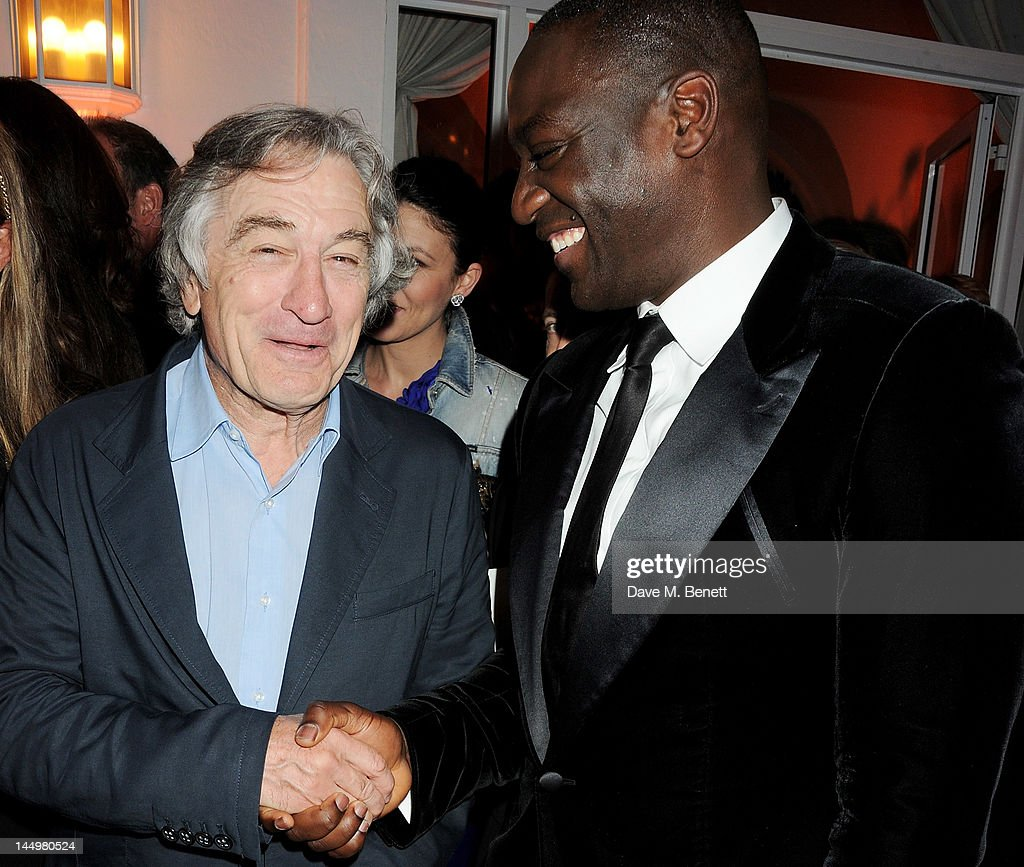 Robert De Niro (L) and <a gi-track='captionPersonalityLinkClicked' href=/galleries/search?phrase=Adewale+Akinnuoye-Agbaje&family=editorial&specificpeople=787923 ng-click='$event.stopPropagation()'>Adewale Akinnuoye-Agbaje</a> attend the IWC and Finch's Quarterly Review Annual Filmmakers Dinner at Hotel Du Cap-Eden Roc on May 21, 2012 in Antibes, France.