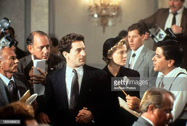 Robert De Niro and Annette Bening are hounded by reporters in a scene from the film 'Guilty By Suspicion' 1991