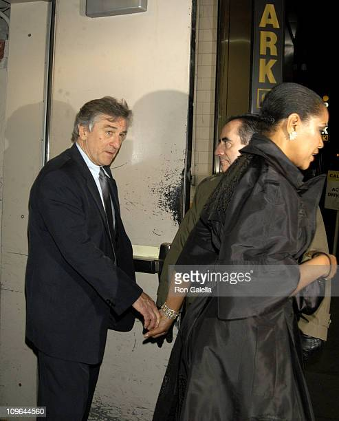 Robert De Niro and Grace Hightower during 'The Good Shepherd' New York Premiere Departures at Ziegfeld Theater in New York New York United States