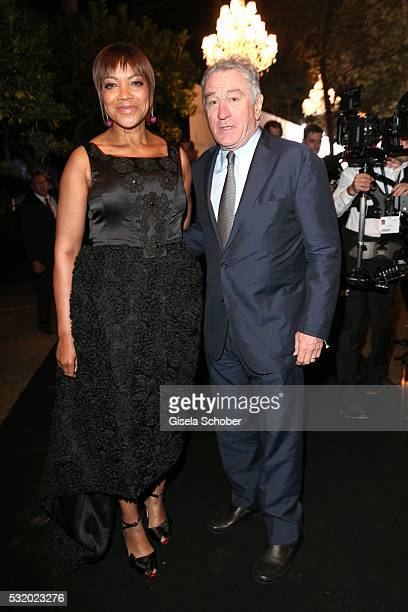 Robert De Niro and his wife Grace Hightower during the 'De Grisogono' Party at the annual 69th Cannes Film Festival at Hotel du CapEdenRoc on May 17...
