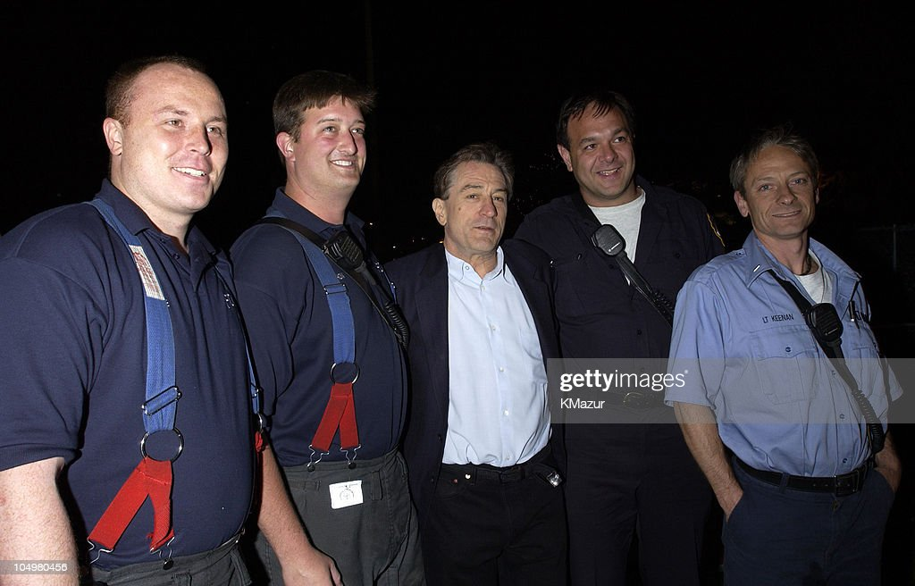 Robert De Niro and New York City firefighters during MTV's Rock and Comedy Concert - Backstage at Battery Park in New York City, New York, United States.