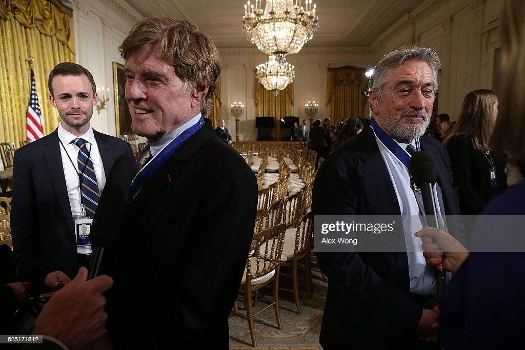 Robert De Niro (R) and Robert Redford (L) speak to members of the media after a Presidential Medal of Freedom presentation ceremony at the East Room of the White House November 22, 2016 in Washington, DC. The Presidential Medal of Freedom is the highest honor for civilians in the United States of America.
