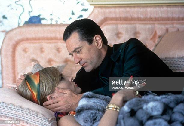 Robert De Niro and Sharon Stone having a tender moment as they lay on a bed in a scene from the film 'Casino' 1995