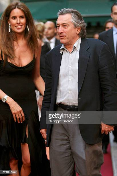 Robert De Niro and Tiziana Rocca arrives at the inaugural ceremony of the Robert De Niro Sr painting exhibition on May 16 2005 in Rome Italy
