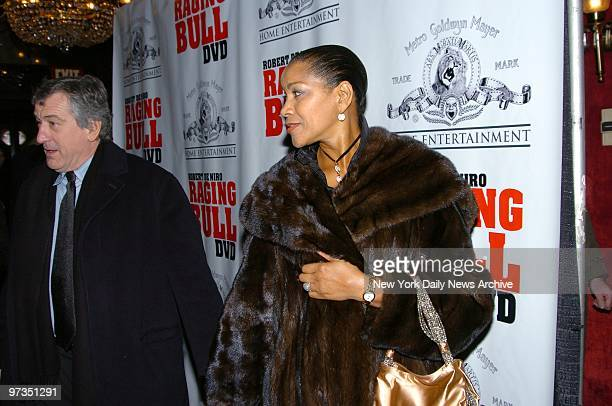 Robert De Niro and wife Grace Hightower arrive at the Ziegfeld Theater for a special screening to celebrate the 25th anniversary of 'Raging Bull' the...