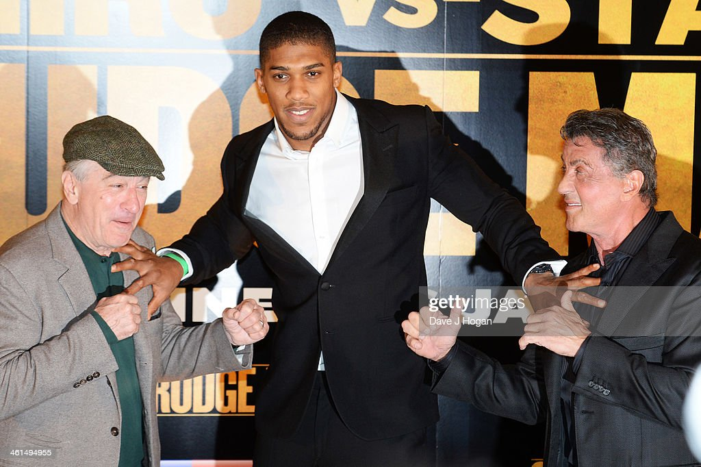 Robert De Niro, Anthony Joshua and Sylvestor Stallone attend a photo call for 'Grudge Match' at The Dorchester Hotel on January 9, 2014 in London, England.