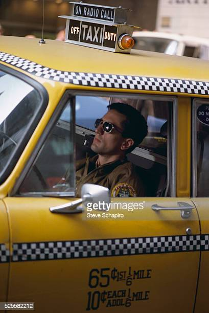 Robert De Niro as Travis Bickle driving a cab in Martin Scorsese's Taxi Driver