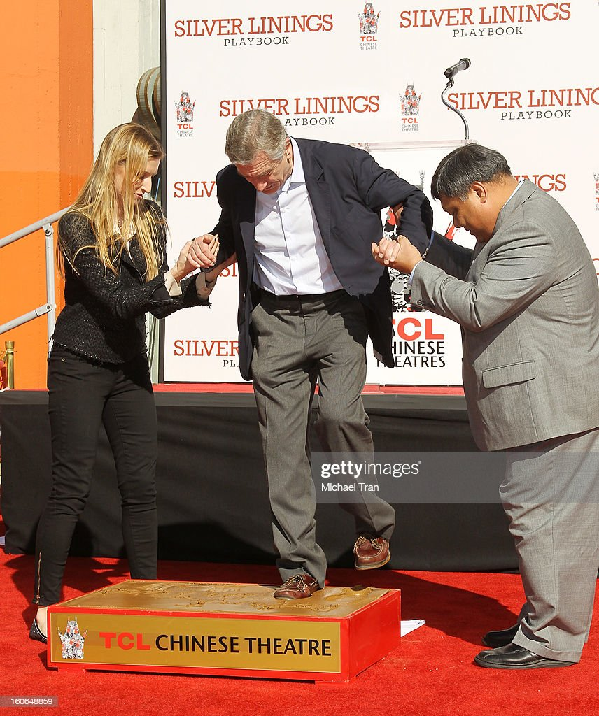 <a gi-track='captionPersonalityLinkClicked' href=/galleries/search?phrase=Robert+De+Niro&family=editorial&specificpeople=201673 ng-click='$event.stopPropagation()'>Robert De Niro</a> (C) attends his hand and footprint ceremony held in conjunction with the film 'Silver Linings Playbook' held at TCL Chinese Theatre on February 4, 2013 in Hollywood, California.