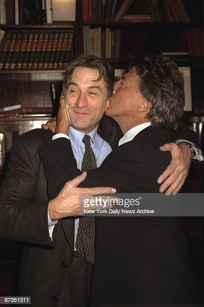 Robert De Niro gets a big kiss from Dustin Hoffman at the screening party at LeCirque for the movie 'Wag The Dog' They star in the film