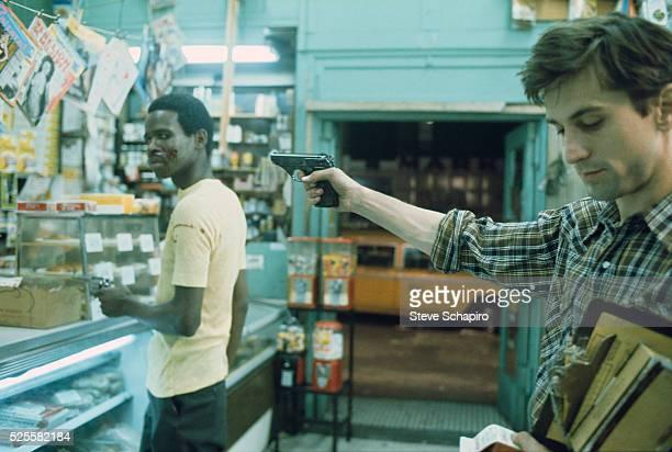 Robert De Niro rehearses convenience store shooting scene during filming Martin Scorsese's Taxi Driver