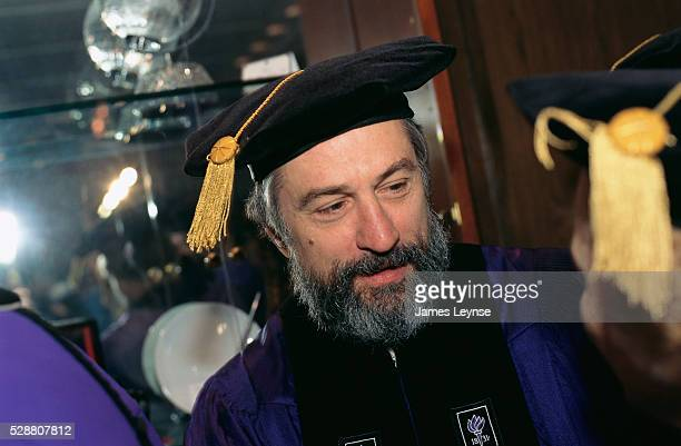 Robert De Niro speaks to fellow graduates at the New York University graduation ceremony De Niro is receiving an honorary doctorate degree in fine...