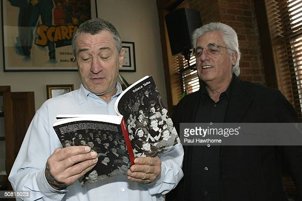 Robert De Niro speaks to Germaino Chelant director of Fondazione Prada at De Niro's office at the Tribeca Film Center during the 2004 Tribeca Film...