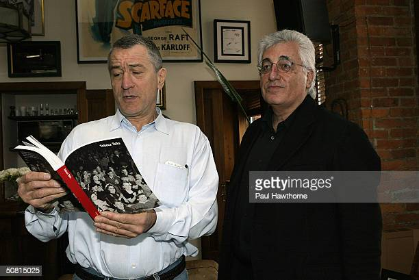 Robert De Niro speaks to Germaino Chelant director of Fondazione Prada at De Niro's office at the Tribeca Film Center during the 2004 Tribeca Film...
