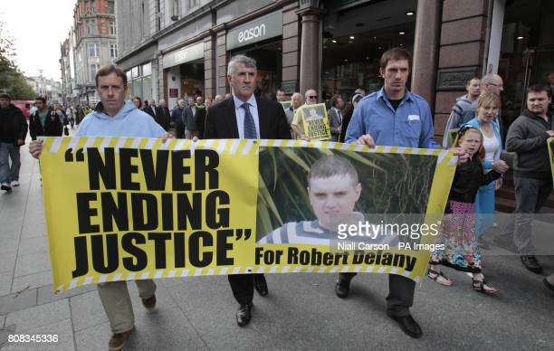Robert Delany's father Terry joins An Post workers and other members of the Justice for Robert Delany Campaign outside Eason's bookstore on O'Connell...