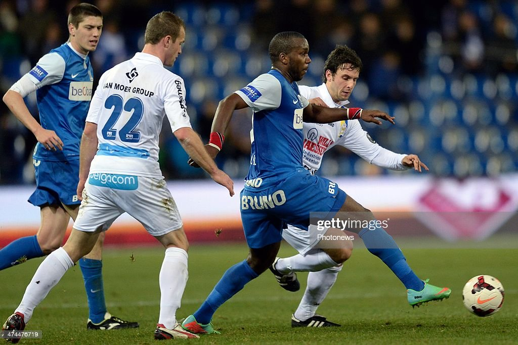 Robert Demjan of Waasland Beveren and Siebe Blondelle of Waasland Beveren battle for the ball with <a gi-track='captionPersonalityLinkClicked' href=/galleries/search?phrase=Khaleem+Hyland&family=editorial&specificpeople=5366394 ng-click='$event.stopPropagation()'>Khaleem Hyland</a> of KRC Genk and Jeroen Simaeys of KRC Genk during the Jupiler League match between KRC Genk and Waasland Beveren on February 23, 2014 in Genk, Belgium.