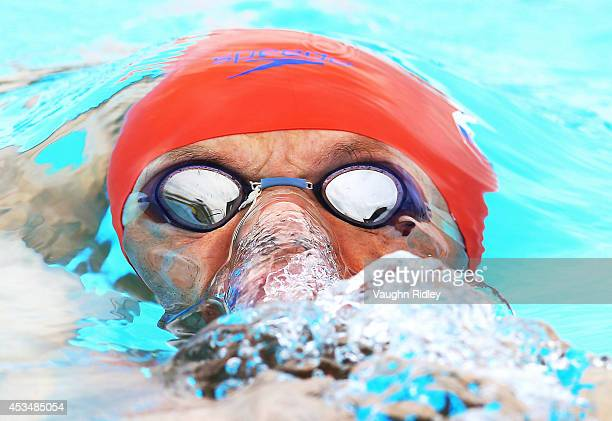 Robert Dinka of Slovakia competes in the Men's 400m Individual Medley at Parc JeanDrapeau during the 15th FINA World Masters Championships on August...
