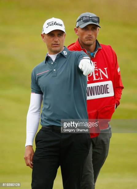 Robert Dinwiddie of England and his caddie look on during the first round of the 146th Open Championship at Royal Birkdale on July 20 2017 in...
