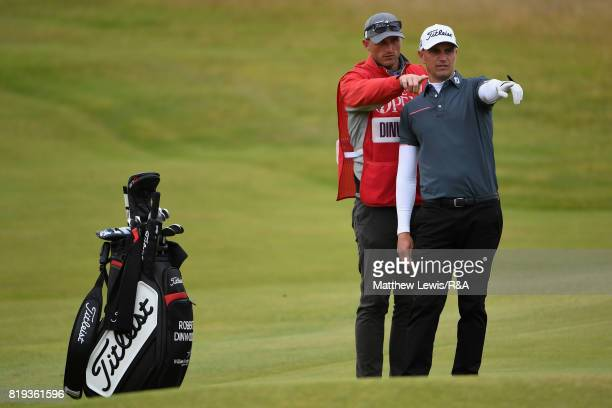 Robert Dinwiddie of England and his caddie on the fourth hole during the first round of the 146th Open Championship at Royal Birkdale on July 20 2017...