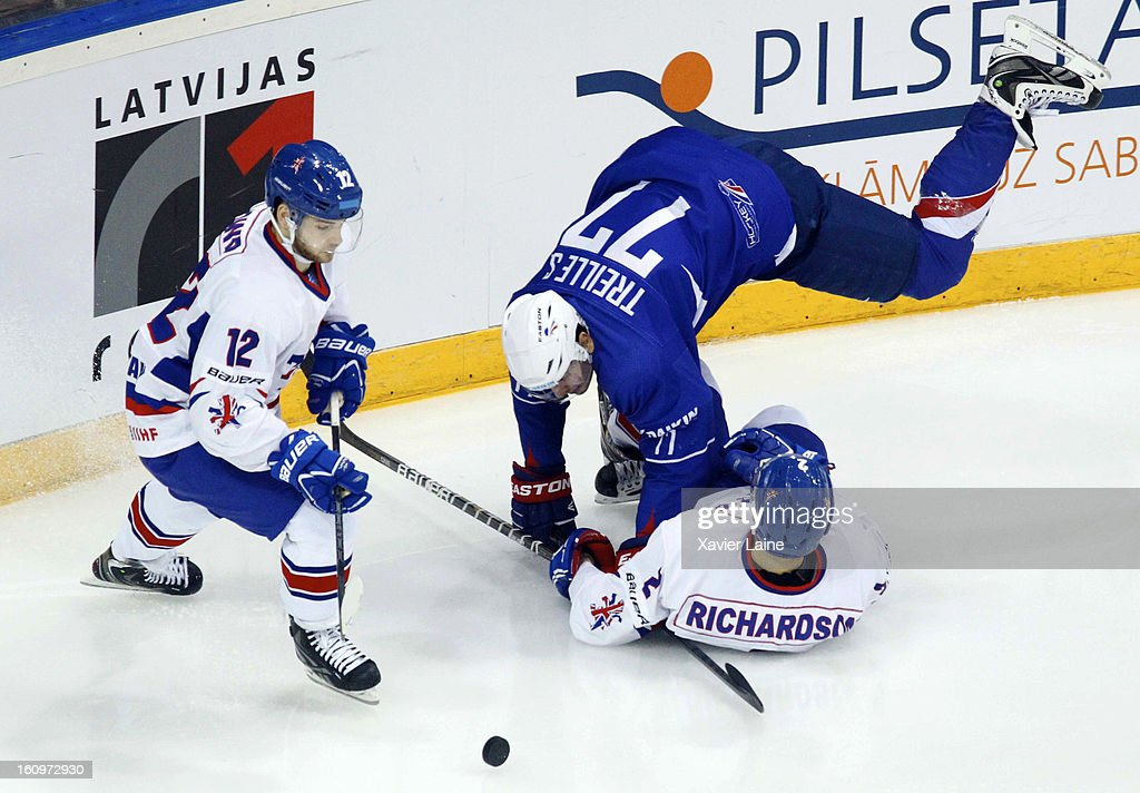 Robert Dowd and Mark Richardson of Great Britain in action against Sacha Treille of France during the Sochi 2014 Olympic Ice Hockey Qualification match between France and Great Britain at Riga Arena on February 8, 2013 in Riga, Latvia.