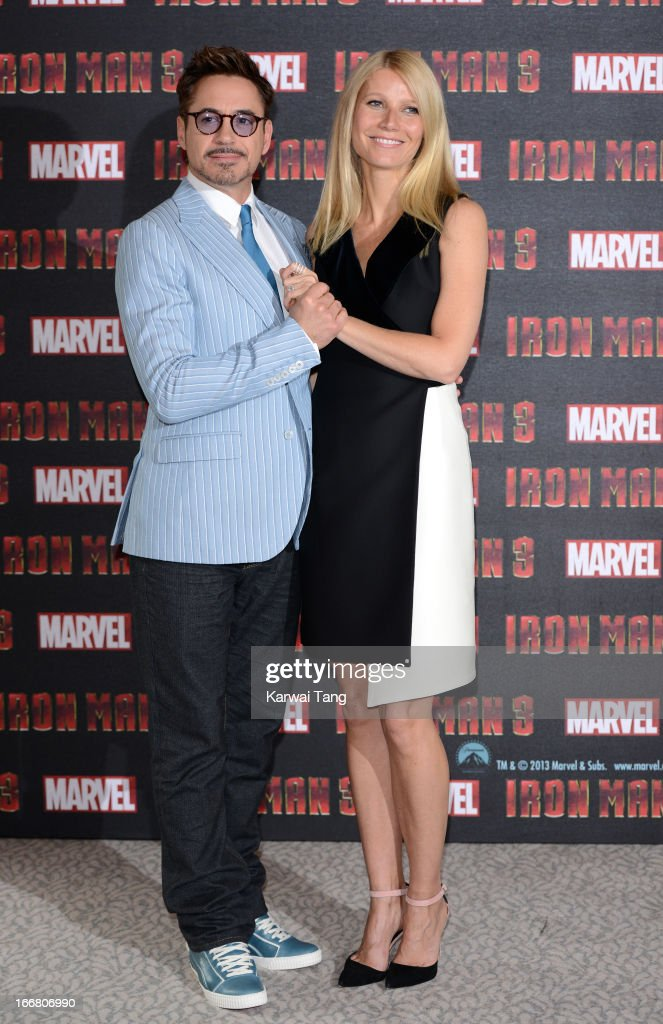 Robert Downey Jnr and Gwyneth Paltrow attend the Iron Man 3 photocall at The Dorchester on April 17, 2013 in London, England.