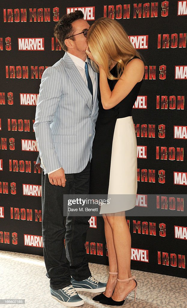 Robert Downey Jr (L) and <a gi-track='captionPersonalityLinkClicked' href=/galleries/search?phrase=Gwyneth+Paltrow&family=editorial&specificpeople=171431 ng-click='$event.stopPropagation()'>Gwyneth Paltrow</a> pose at the Iron Man 3 photocall at The Dorchester on April 17, 2013 in London, England.