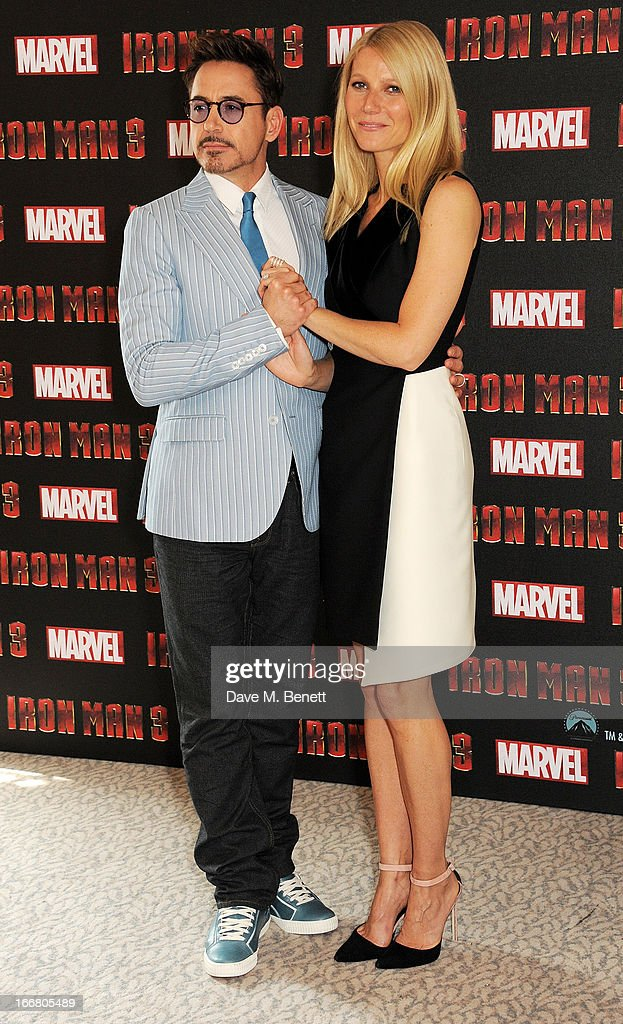 Robert Downey Jr (L) and Gwyneth Paltrow pose at the Iron Man 3 photocall at The Dorchester on April 17, 2013 in London, England.