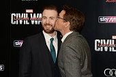 Robert Downey Jr kisses Chris Evans during the European film premiere of 'Captain America Civil War' at Vue Westfield on April 26 2016 in London...