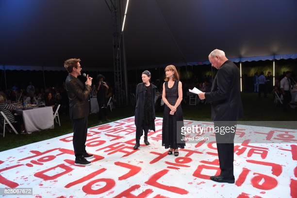 Robert Downey Jr Laurie Anderson Isabelle Huppert and Robert Wilson attend The 24th Annual Watermill Center Summer Benefit Auction at The Watermill...