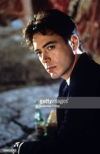 Robert Downey Jr looking to his left in a scene from the film 'Only You' 1994