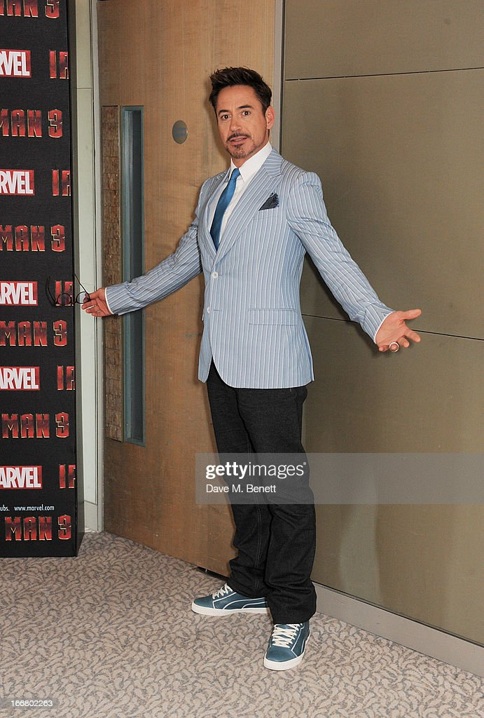 Robert Downey Jr poses at the Iron Man 3 photocall at The Dorchester on April 17, 2013 in London, England.