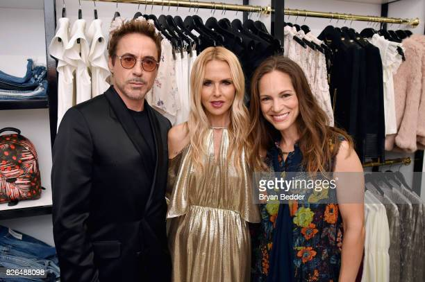 Robert Downey Jr Rachel Zoe and Susan Downey attend the Rachel Zoe x What Goes Around Comes Around popin on August 4 2017 in East Hampton New York
