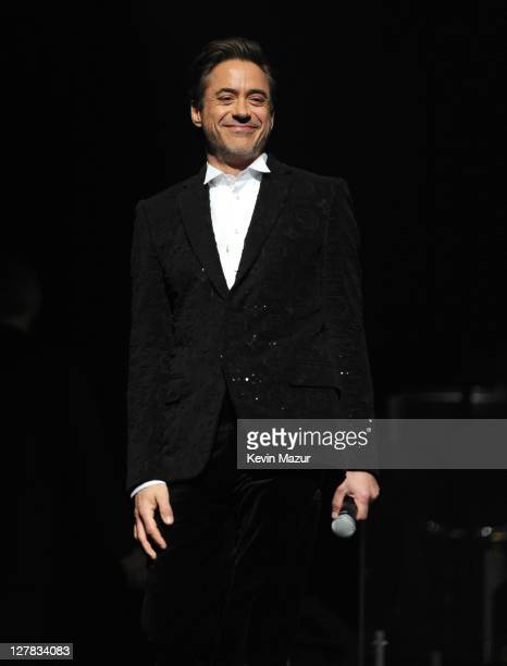 Robert Downey Jr speaks on stage during STING 25th Anniversary/60th Birthday Concert to Benefit Robin Hood Foundation at Beacon Theatre on October 1...