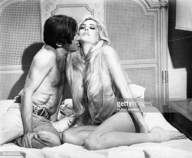 Robert Drivas kisses Edy Williams in a scene for the United Artist movie 'Where It's At' circa 1968