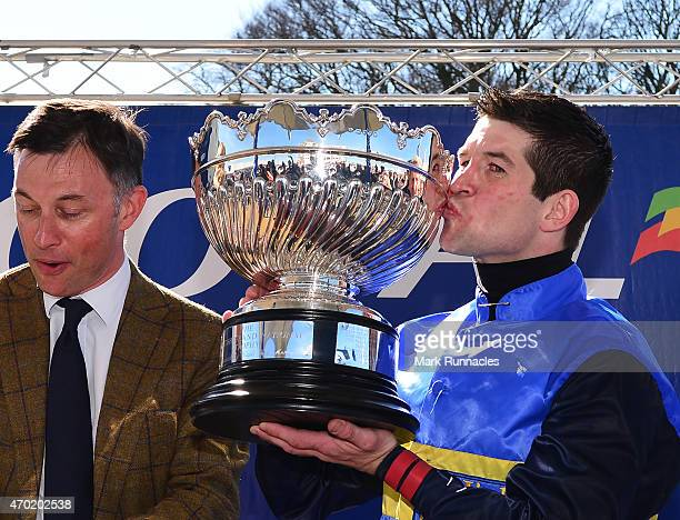 Robert Dunn kisses the trophy after winning the Coral Scottish Grand National Handicap Chase on the second day of the Scottish Grand National...