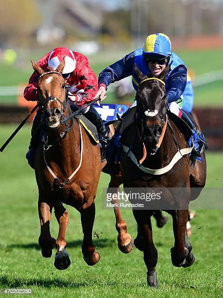 Robert Dunn on Wayward Prince sprints for the line as he wins the Coral Scottish Grand National Handicap Chase on the second day of the Scottish...