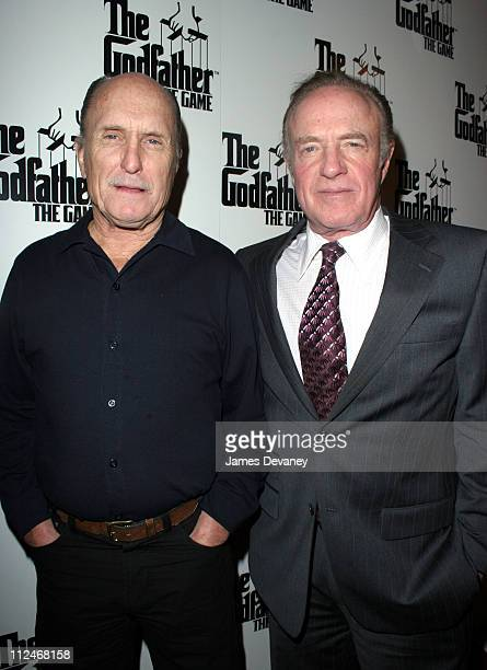 Robert Duvall and James Caan during EA Games Launches ''The Godfather'' the Game at Il Cortile in New York City New York United States