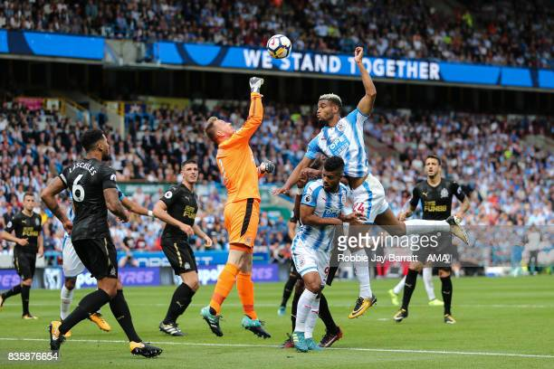 Robert Elliot of Newcastle United and Steve Mounie of Huddersfield Town during the Premier League match between Huddersfield Town and Newcastle...